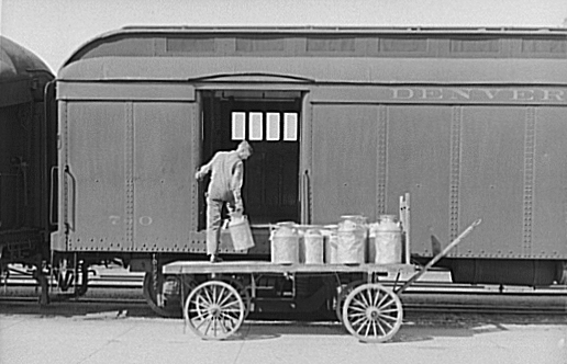 unloading milk cans from a milk run train