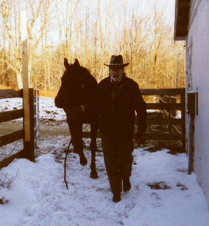 Cowboy Bob leading a formerly unruly horse