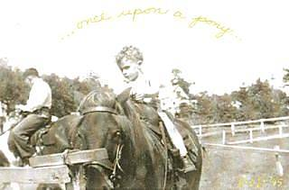 Two-year-old Cowboy Bob on a pony